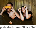 Family in nature with oranges 20379767