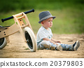 Little boy with tricycle in nature 20379803
