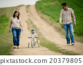 Family with little boy on tricycle in nature 20379805