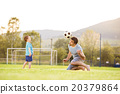 Father and son playing football 20379864