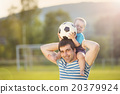 Father and son playing football 20379924