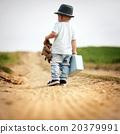 Little boy walking in nature 20379991