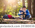 Father and son in the forest 20380036