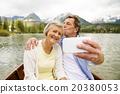 Senior couple on boat 20380053