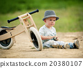Little boy with tricycle in nature 20380107