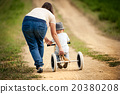 Mother with little boy on tricycle in nature 20380208