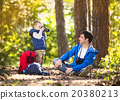 Father and son in the forest 20380213