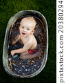 Little boy bathing outside 20380294