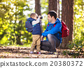 Father and son in the forest 20380372