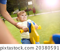 Father and child on playground 20380591