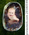 Little boy bathing outside 20380599