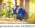 Father and son in the forest 20380624