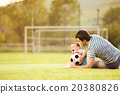 Father and son playing football 20380826