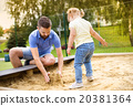 Father and child on playground 20381364