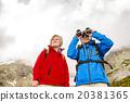 Senior hikers with binoculars 20381365