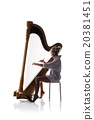 Silhouette of woman with harp 20381451