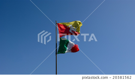 Flags of Sicily and Italy, against the blue sky 20381562