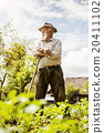 Old farmer on the meadow 20411102