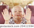 Boy travelling in train 20411594