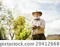 Old farmer on the meadow 20412668
