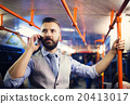 Hipster businessman with mobile phone on tram 20413017