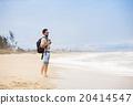 Man walking on the beach 20414547
