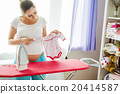 Pregnant woman ironing 20414587