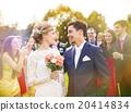 Newlyweds at wedding reception 20414834