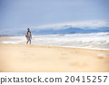 Man walking on the beach 20415257