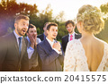Groomsmen looking at bride 20415575