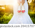 Bride holding wedding shoes 20415707