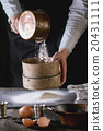 Sifting flour by female hands 20431111