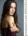 Beautiful girl with long direct hair. Brunette 20431911