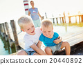 Mother with sons on the pier, lighthouse, sunny 20440892