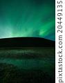 Aurora borealis above a mountain 20449135