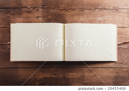 Stock Photo: Photo album on wooden desk
