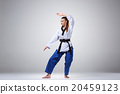 The karate girl with black belt  20459123