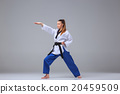 The karate girl with black belt  20459509