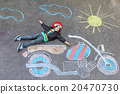 Little kid boy in helmet with motorcycle chalk 20470730