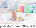 Cute baby on white bed 20476439