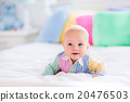 Cute baby on white bed 20476503