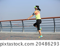 young fitness woman jumping rope at seaside 20486293