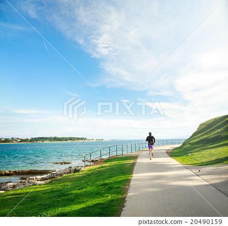 Man Running on the Sea Coast 20490159