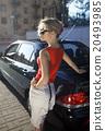 blonde woman near black car 20493985