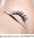 Woman beautiful long eyelashes in cosmetics salon 20496879