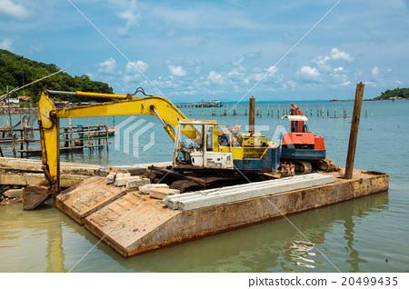 Yellow and orange excavator machine 20499435