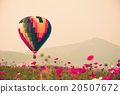 Colorful hot air balloon is flying at sunset. 20507672