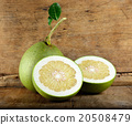 Pomelo fruit on the wooden background 20508479