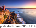 Sunrise seascape and red-white lighthouse 20553314