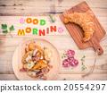 Breakfast  setup on wooden table. 20554297